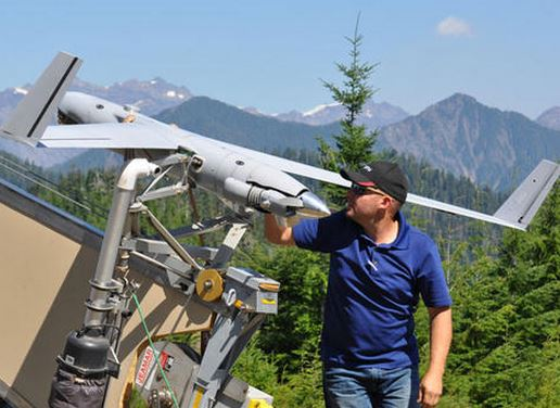 Insitu operator Joseph Cooper prepares the ScanEagle UAS for launch to surveil the Paradise Fire in Olympic National Park earlier this August.