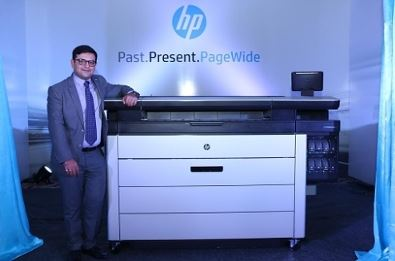 Mr. Devang Karia, Country Manager, Large Format Design, PPS, HP India with the newly launched HP PageWide XL 8000 series printer