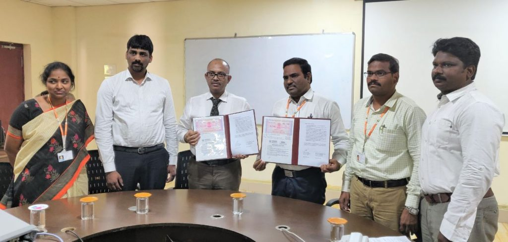 Wing Commander Polu Sreedhar, Chief Operating Office, Terra Drone India (center left) and Dr. G. Srinivasa Rao, Dean - R&D, Vignan's (center right) with team members