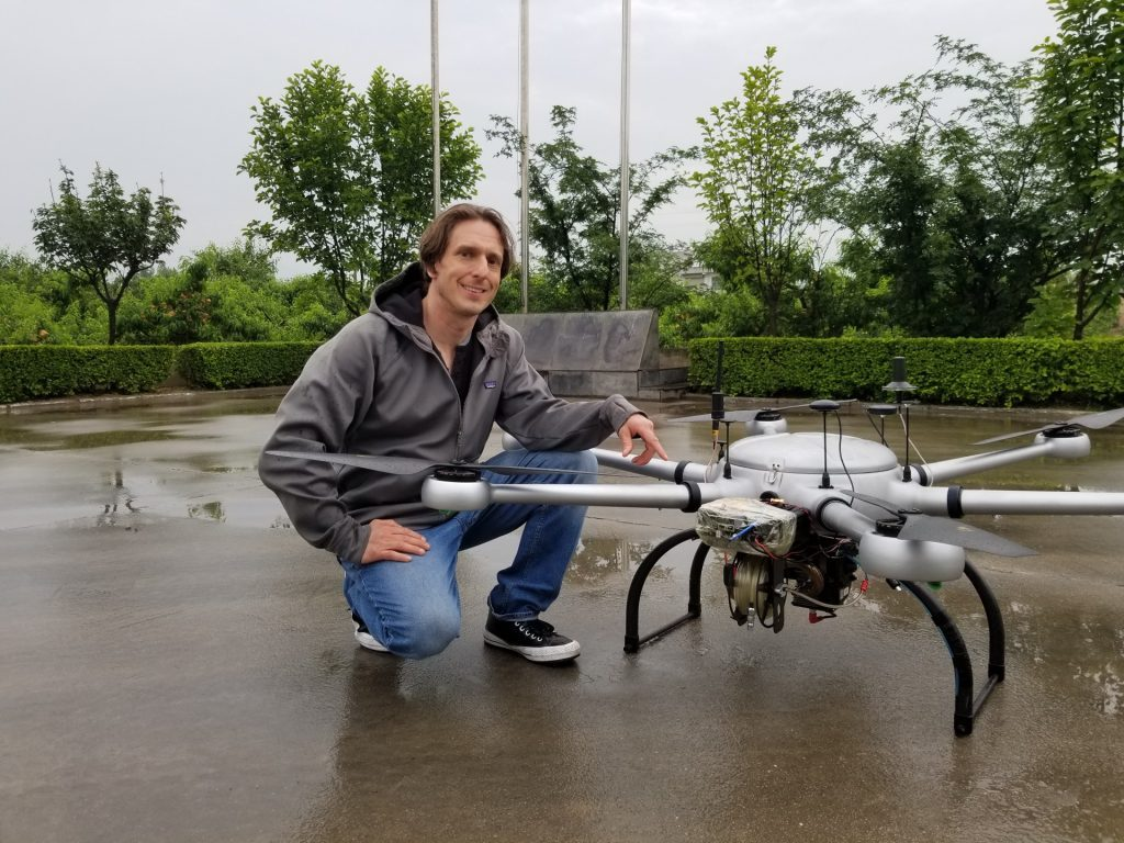 Remote Geo's Jeff Dahlke with the gas-powered hexcopter BVLOS patrol drone