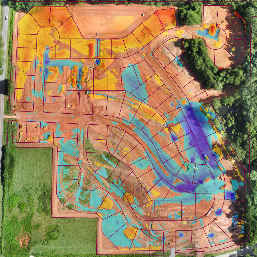 Assessing cut (red) and fill (blue) on a construction site using drone surveying.
