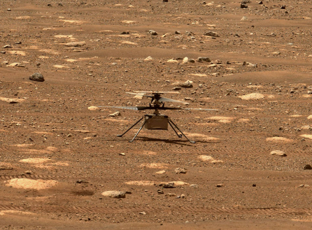 NASA's Ingenuity helicopter unlocked its blades, allowing them to spin freely, on April 7, 2021, the 47th Martian day, or sol, of the mission. This image was captured by the Mastcam-Z imager aboard NASA's Perseverance Mars rover on the following sol, April 8, 2021. Credits: NASA/JPL-Caltech